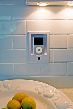 We installed an iPod docking station in the subway tile backsplash that is hardwired to speakers in the kitchen and family room in a Town and Country addition.