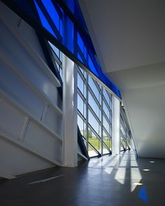 Devon Boathouse by Elliott + Associates Architects - Main entry lobby looking northwest from under stair