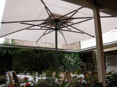This beautiful Magnum, with white canopy, looks stunning in a courtyard, and creates an outside room without a permanent structure.