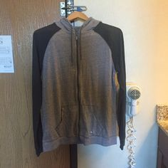 Under Armour Loose Heat Gear XL Gray Full Zip Hoodie. Good used condition. No stains or tears. Loose fitting XL Under Armour Tops Sweatshirts & Hoodies