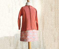 Conjunto de sueter y falda para niña en color naranja de Renattoni