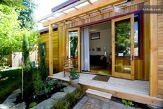 """435 Sq Ft Tiny Eco House in Portland OR-01. """"The Pocket House is a brand new structure (2010) designed by Jason Swift and Wendy Turner of Swift Architecture that beautifully blends modern Scandinavian aesthetic with sustainable Pacific Northwest sensibility. The result is an inviting 435 square-foot space, one bedroom home with a fully functional kitchenette, separate sleeping loft and a private garden space."""""""