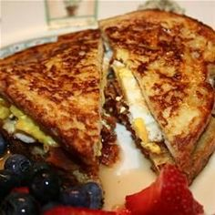 French Egg and Bacon Sandwich | Mmm, French Toast with eggs and bacon in the center!