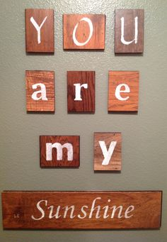 """You are my sunshine"" wall art created from wood flooring samples."