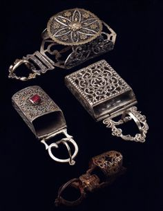 Morocco | Four belt buckles; silver, silver gilt, enamel, glass cabochon and brass alloy.