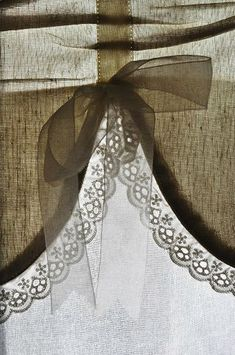 sheer ash grey window treatment with ribbon and lace trim