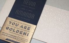 Gold letterpress on black paper, Metallic gold band   Amanda and Kevin Brand Invitation by Frances Close