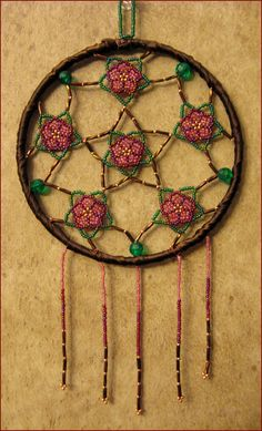 Beaded Dreamcatcher!  Pattern from Sun Catchers Beaded Jewelry by Jeanette Shanigan