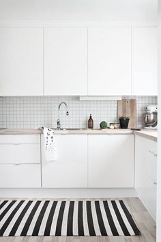 This white #kitchen looks straight out of a #Scandinavian dream. The simple stack tile and the soft color of the counters make it easy on the eyes and I'm sure a joy to cook in! #ThisOldHouse inspiration via www.L-2-Design.com
