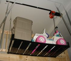 Powered electric hoist which includes a metal platform for totes other bulky items.