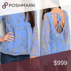 """🌺 S-L Paisley Bell Sleeve Peasant Boho Blouse This is one of my new favorites! Sweet in the front and sassy in the back. Gorgeous indigo colored paisley bell sleeved Blouse with scoop back and lace up detail. The sleeves are sheer but the body is lined and not sheer. 100% Polyester, Made in USA. Length is 28"""" and bust is 16"""" on the small... size up for looser fit. S-L available! No trades Tops"""