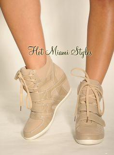 $44.99: https://www.hotmiamistyles.com/Beige_Strap_Lace_Up_Hidden_Wedge_Sneaker_Boot_p/g-2313%20taupe-beige.htm