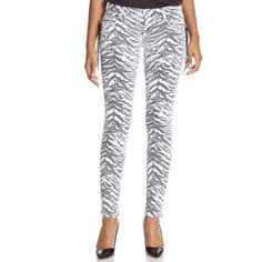 """Hudson Zebra Print Skinny Jean Exotic print upgrades super skinny style. Tassel details on front mock pockets. Set-on waistband with belt loops. Button closure. Zip fly. Front coin and mock zip pocket. Back button flap pockets. Cotton/polyester/lycra. Machine wash. Made in USA. Color: white - black. 91.5% cotton, 6% polyester, 2.5% Lycra. Inseam is approx. 29 1/4"""". Laying flat, waist measures approx. 13 1/4"""" across. Hudson Jeans Jeans Skinny"""