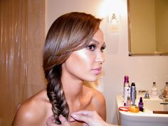 Fishtail side braid and long lashes on Joan Smalls for the 2014 Met Gala.