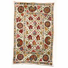 Beautiful embroidery from Uzbekistan, but also found in Afghanistan.  http://www.etsy.com/listing/88774947/vintage-embroidered-textile-uzbek-suzani