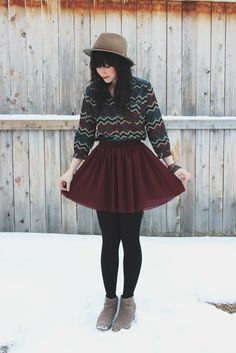 Patterned shirt with burgundy skirt