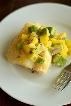 Spicy paleo coconut cod fillets topped with sweet mango avocado salsa. Healthy dinner in under 30 minutes! Gluten free, egg free and dairy free.