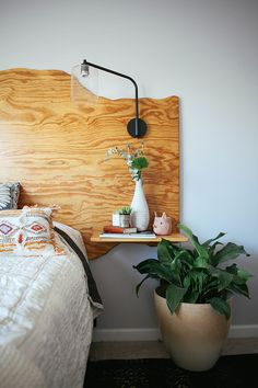 A budget DIY riff on live-edge slab headboards, with plywood instead.