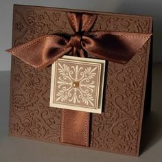 handmade card ... square format ... chocolate browns ... simple and elegant ... embossing folder texture ... square tile design focal point ...  shiny knotted ribbon ... by savannah