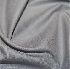 Light Grey / silver cotton canvas, medium weight, A great fabric for creating bags, craft items, with a lovely feel and drap Width (cm): 140 Width (inch): 55 Wash: 30 degrees Iron: medium Tumble dry: low Do not bleach.