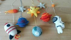 This is a a cute space baby mobile made out of a crochet: - astronaut - two planets - planet Earth - rocket ship - sun - fireball - two stars - small ball Its perfect for decorating space inspired nursery room and its suitable for neutral gender nursery. Youll receive a space mobile hang