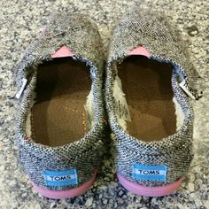 KIDS VELCRO TOMS! Adorable velcro pink and gray little girl TOMS! Fabric has a little sparkle/shimmer to it. They have been preloved, but are clean overall. Small stain (pic #2) on the pink stretchy material in the middle. They have been washed. Size T10. I can see another little lady loving these.  Use reflects lower price for TOMS. TOMS Shoes Flats & Loafers