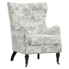 $394.95: A perfect addition to your living room or master suite, this charming wingback arm chair showcases a toile motif, nailhead trim, and turned front caster feet...