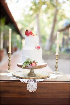 From: Le Magnifique  Photography: Diana McGregor Photography Beautiful rough iced buttercream wedding cake adorned with fresh fruit!