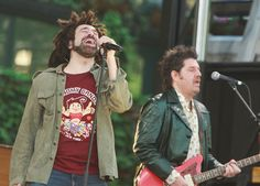 "Adam Duritz Photos Photos - Singer Adam Duritz and guitarist Dave Bryson of Counting Crows poses for a photo with fans on ABC's ""Good Morning America"" in Bryant Park on Friday May 23, 2008 in New York City. - Counting Crows Perform On ABC's ""Good Morning America"""