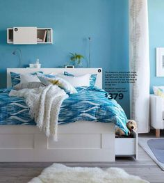 BRIMNES bed from IKEA - great for extra storage. I like that shade of blue paint with the white furniture too