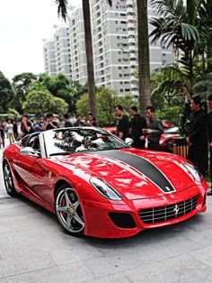 The Ferrari 599 is a sports car. The car was unveiled at the 2006 Geneva Motor Show. The car is available in coupe and convertible models Ferrari Daytona, Ferrari Ff, Vin Diesel, Wheel Alignment, Ferrari California, Car Manufacturers, Car Car, Hot Cars, Car Show