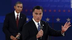 122 U.S. President Barack Obama listens to Republican presidential candidate Mitt Romney.  October 16, 2012