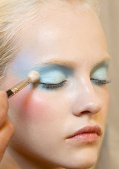 Pastel blue eyeshadow + rosy cheeks.