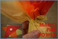 HAHAHA i want to make these and throw them at people! Super Mario Fire Power - Fire Balls    1. Just take yellow, orange, and red tissue paper and cut it in half diagonally.  2. Place a styrofoam ball in the middle.  3. Close the tissue paper around the ball and secure it with a rubber band.