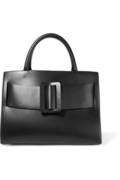 """""""Once we have this little flame, we're pretty good at compounding it to make a big enough fire that people might just want to gather around it,"""" tells co-founder Jesse Dorsey of how each Boyy design starts with a spark of inspiration. Part of the Spring '17 collection, this tote is made from soft black leather. It hangs from a detachable shoulder strap and has an adjustable front buckle to streamline or expand the shape."""