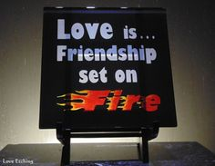"""You are looking at ONE etched glass wall tile. It has """"Love is Friendship set on Fire"""" etched on it. You can display it on an easel as shown (not included), set it directly on a table, tile it into yo Etched Wine Glasses, Etched Glass, Glass Etching, Black Wall Tiles, Black Walls, Glass Coffee Mugs, Beer Mugs, Champagne Flutes, Glass Candle Holders"""