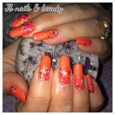 Orange gel polish on natural nails with neon glitter