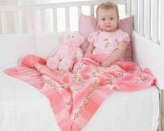 Follow this free knit pattern to create this baby blanket using Bernat Jacquards Florals yarn.
