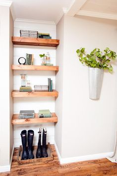 For a more contemporary look, Chip and Joanna Gaines paired painted shiplap siding with thick, streamlined wood shelves in this built-in shelving unit.