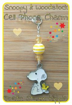 Deck out your phone with this super cute Snoopy & Woodstock cell phone charm. This cell phone charm is on a clear dust plug that fits your standard size headphone jack. It will protect your jack from dust and moisture while adding some awesomeness to your phone! Only one like this available. I ab...