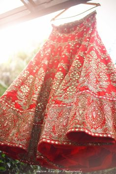 mirror work bridal lehenga , red bridal lehenga ,red silk bridal lehenga , lehenga on hanger, horizontal patterms
