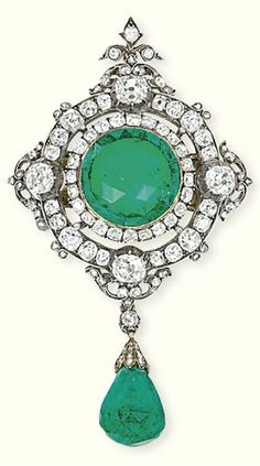 AN ANTIQUE EMERALD AND DIAMOND BROOCH The rose-cut emerald within an old-cut diamond tiered surround with diamond collet quarter detail suspending a briolette-cut emerald drop, circa 1860, 7.7 cm long
