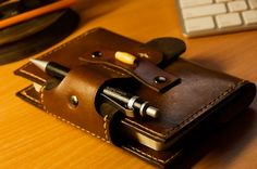 Moleskin leather case with pen holder. Will hold cash & cards inside as well. Made it for an upcoming United Way auction.