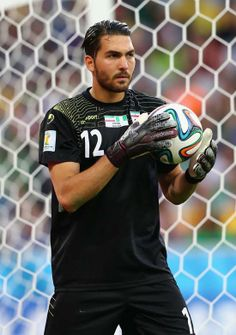 Alireza Haghighi Photos - Alireza Haghighi of Iran holds the ball during the 2014 FIFA World Cup Brazil Group F match between Iran and Nigeria at Arena da Baixada on June 2014 in Curitiba, Brazil. - Iran v Nigeria: Group F Iran National Football Team, Iran Football, Iran Soccer, World Cup 2014, Fifa World Cup, Iran Sport, New Africa, Africa News, South Africa