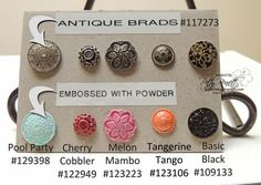 Antique Brads heat embossed with colored embossing powder. Neat idea!