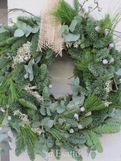 Love the combination of eucalyptus and evergreen in this wreath