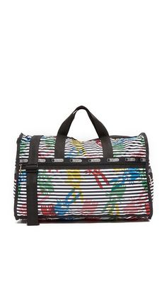 A collaboration between LeSportsac and Danish designer Peter Jensen. Jensen's Signature rabbit graphic details this patterned LeSportsac duffel bag. Logo-printed grosgrain trims the front, and zip pockets outfit each side. Optional slim zip pouch. Zip top and spacious, lined interior. Woven top handles and optional, adjustable shoulder strap.
