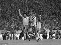 Gerry Francis, after scoring against Scotland in 1975, is embraces by fellow England international Kevin Beattie.