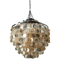 Round Chandlier With Capiz Shells, Gold - $445 Dining rule No. 1: Don't make your guests stare right into bright light. This natural capiz shell chandelier will give off soft light with a wonderful shimmer overhead, setting a relaxed mood.
