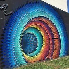 """Hypnotic graffiti by Miami-based street artist Hoxxoh."""